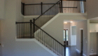Beautiful Dark Stained Split Staircase with metal spindels