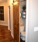 Sliding Barn Door over Powder Bath of Mountain Ash Custom Homne Model
