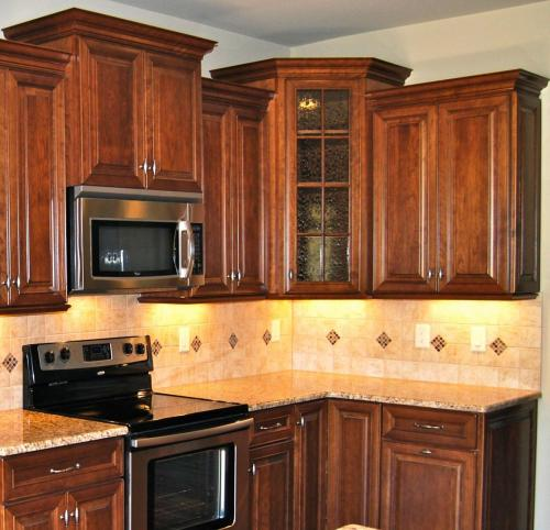 Oak Custom Home Model Kitchen with gorgeous custom cabinets.