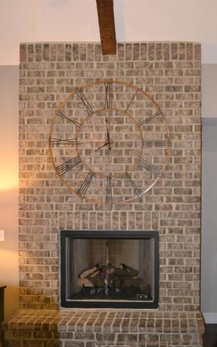 Mountain Ash Custom Model Home with brick fireplace
